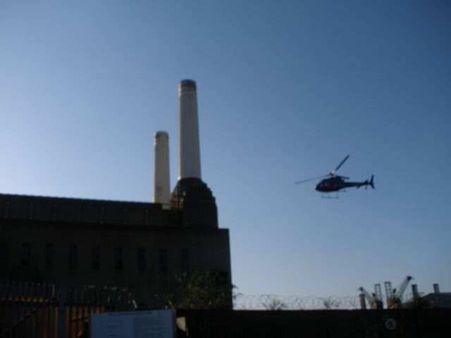 Private helicopter taking off from Battersea Power Station